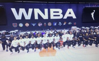 WNBA players kneeling